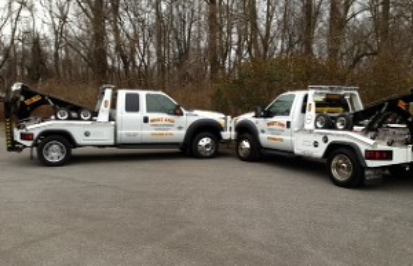 two West End Towing tow trucks